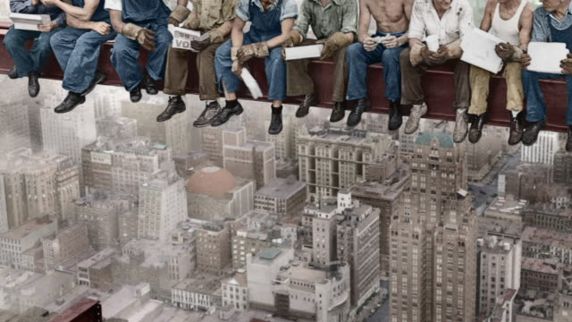 construction workers at the rca building construction site take a break on a girder high above the manhattan cityscape. - girder stock videos & royalty-free footage