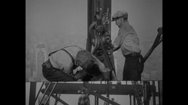 vs qs construction workers at work on steel beams of golden gate bridge / note exact month/day not known documentation incomplete - golden gate bridge stock videos & royalty-free footage
