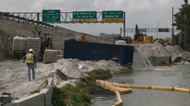 Construction workers build along State Road 836 on February 12 2018 in Miami Florida President Donald Trump announced his infrastructure proposal...
