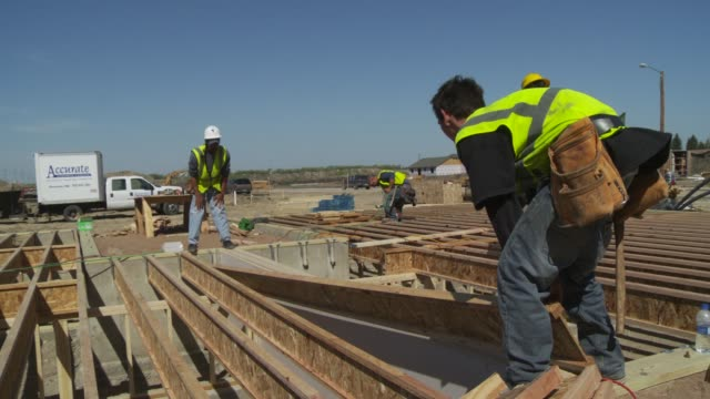 Construction workers build apartments to house oil workers in Tioga, North Dakota.