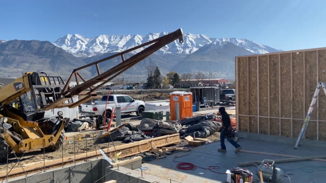 construction workers building residential home in lindon, utah, u.s., on wednesday, april 8, 2020. - manual worker stock videos & royalty-free footage
