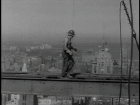 1961 b/w construction workers building skyscraper / united states  - postwar stock videos & royalty-free footage