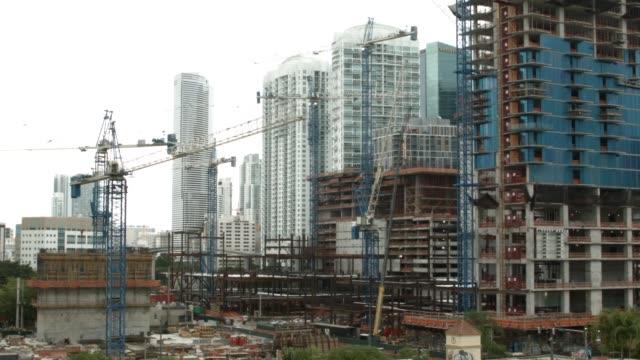 construction workers building the $1.05 billion brickell citycentre condo/retail mix use complex on july 7, 2014 in miami, florida. condo projects... - home economics点の映像素材/bロール