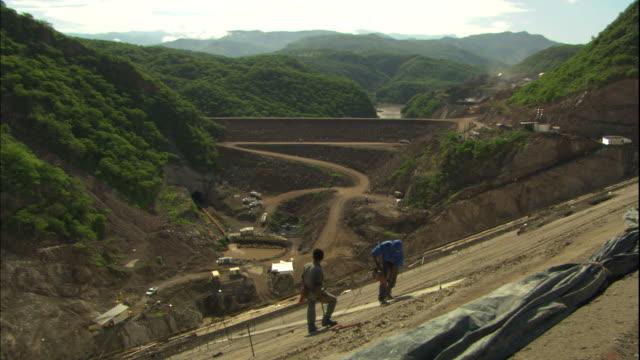 construction workers drill at the el caj�n dam. - argentina america del sud video stock e b–roll