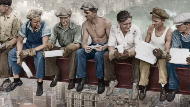 construction workers eat lunch on a girder high above a  manhattan cityscape at the rca building construction site. - girder stock videos & royalty-free footage