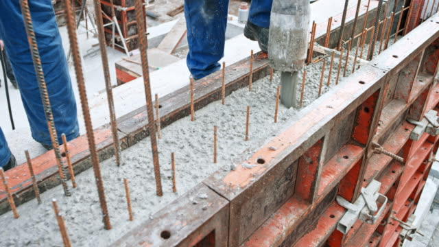 construction workers filling formwork with concrete - concrete stock videos & royalty-free footage