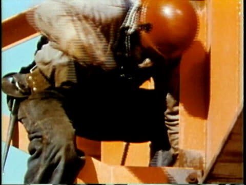 1963 MONTAGE Construction workers fixing steel beams / Chicago, United States / AUDIO