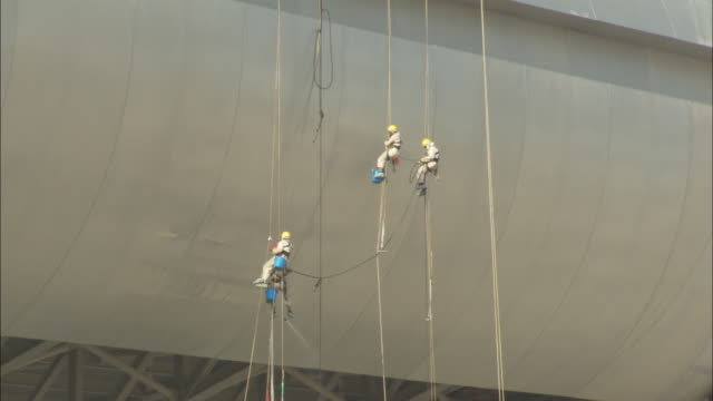 construction workers hang from ropes. - real estate stock videos & royalty-free footage