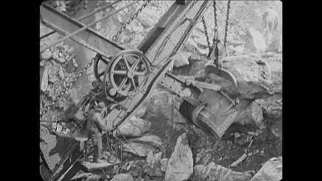 1921 construction workers in nyc using derrick to move large boulders - crane stock videos & royalty-free footage