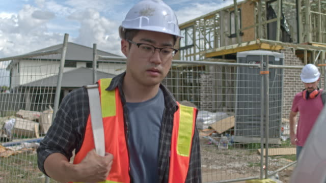 construction workers leaving the construction site - manual worker stock videos & royalty-free footage