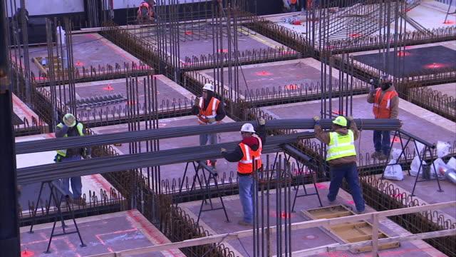 construction workers lower steel beams. - metal stock videos & royalty-free footage
