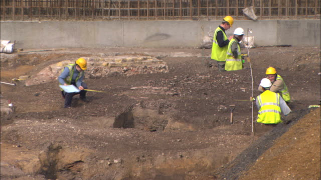 construction workers measure a section of tabard square. - tape measure stock videos & royalty-free footage