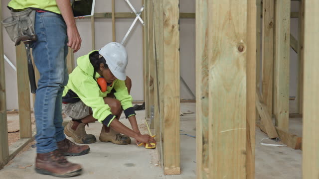 construction workers measuring at site - hard hat stock videos & royalty-free footage