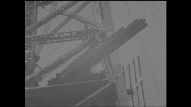 construction workers move a steel section into position as they assemble the exostructure of the tokyo tower. - tokyo tower stock videos and b-roll footage