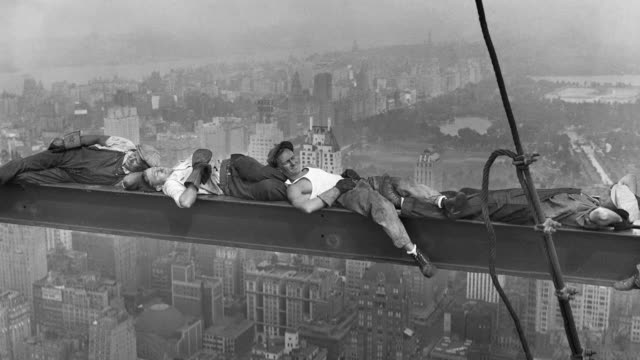 construction workers nap on a steel girder over the manhattan cityscape at the radio city music hall construction site. - girder stock videos & royalty-free footage