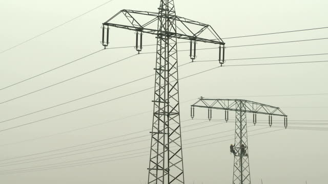 construction workers on a high-voltage pylon - high voltage stock videos & royalty-free footage