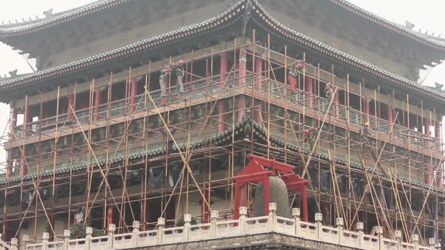 ms construction workers on ancient tower / xi'an, shaanxi, china - traditional helmet stock videos and b-roll footage