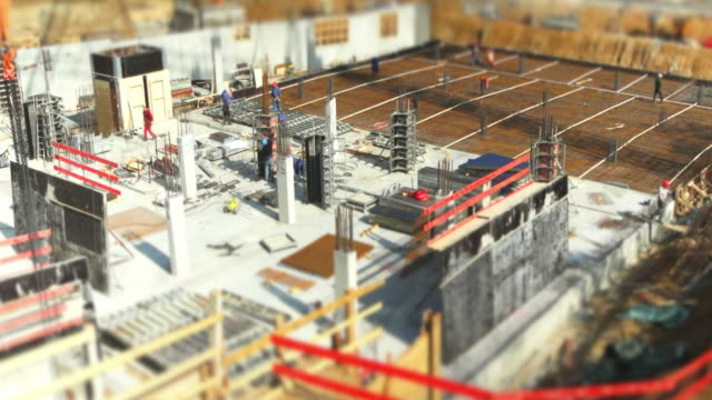 construction workers on site (tilt shift and time lapse) - beton stock videos and b-roll footage