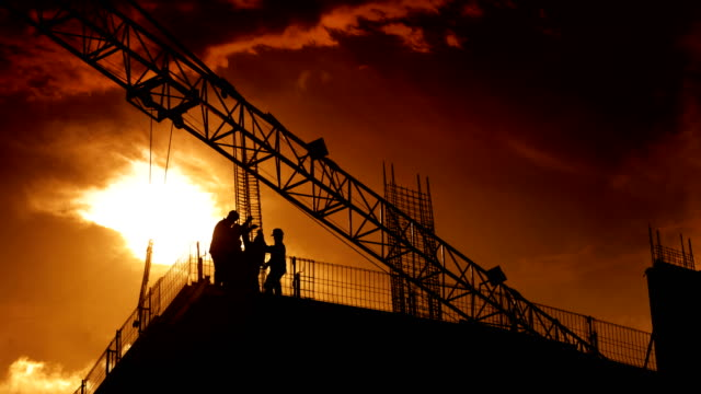 construction workers on top of a building. - cable stock videos & royalty-free footage