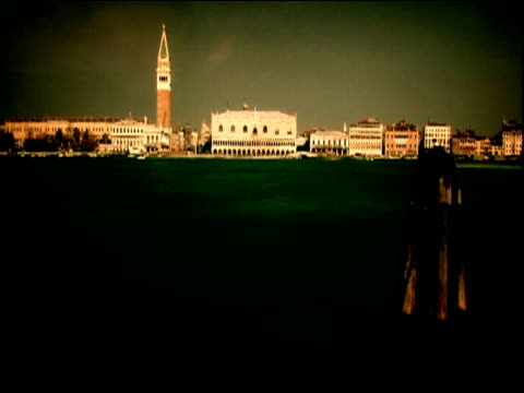 construction workers on wooden platform on lagoon campanile di san marco in background venice - erezione video stock e b–roll