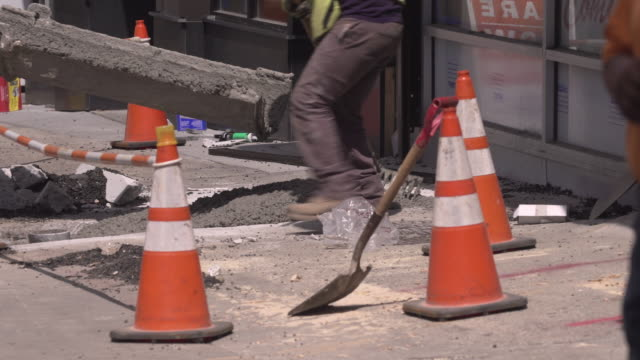 construction workers pour cement down for new sidewalk to be paved. - roadworks stock videos & royalty-free footage