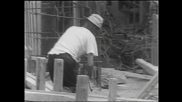 construction workers prepare to build a concrete wall as part of a flood control project. - concrete wall stock videos & royalty-free footage