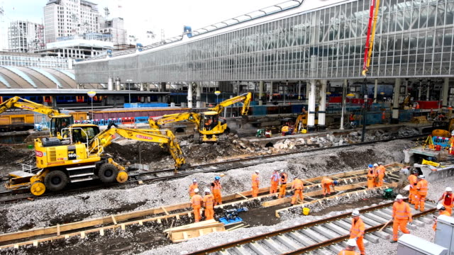 construction workers rebuild platforms and tracks at waterloo train station on august 7 2017 in london england ten platforms at london waterloo... - repairing stock videos & royalty-free footage