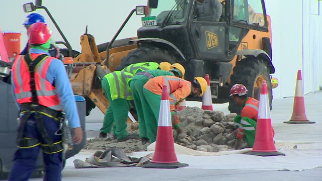 construction workers removing rocks and rubble in the newly constructed louvre abu dhabi - construction worker stock videos & royalty-free footage