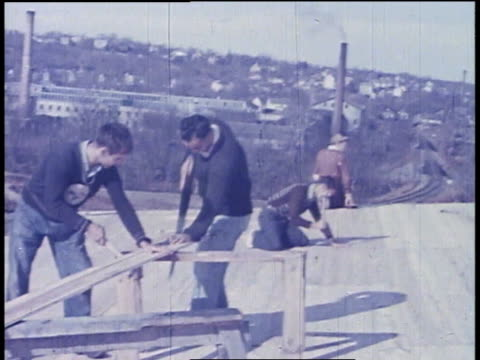 construction workers repairing the roof of a grandstand / nepaug village, connecticut, united states - one teenage boy only stock videos & royalty-free footage