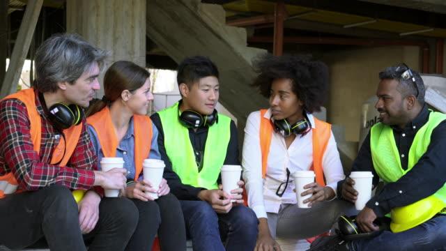 construction workers talking in coffee break - coffee break stock videos & royalty-free footage
