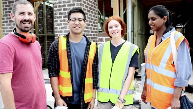 construction workers team portrait. - multiracial group stock videos & royalty-free footage