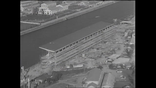 construction workers use a scaffold as they build spectator stands for the toda olympic boat course / shot at toda city in saitama on october 5 1965 - saitama city stock videos & royalty-free footage