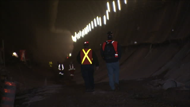 construction workers walk in a tunnel at a niagara river boring operation. - river niagara stock videos & royalty-free footage