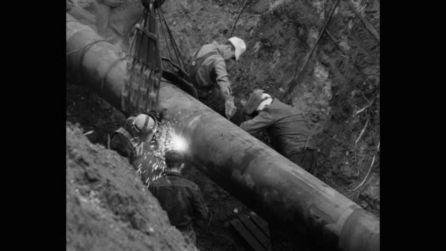 construction workers welding pipes at construction site - construction worker stock videos & royalty-free footage