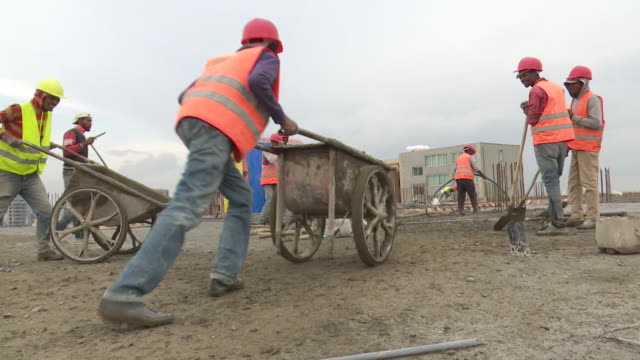 construction workers working on building sites in addis ababa ethiopia - ethiopia stock videos & royalty-free footage