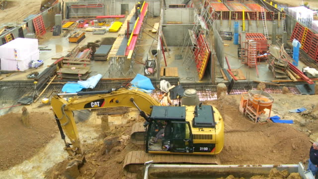 tl construction works for an office building - bagger stock-videos und b-roll-filmmaterial