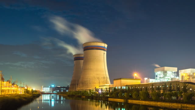 constructions in power plant near water time lapse - water plant stock videos and b-roll footage
