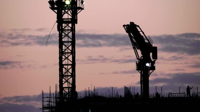 Constructions Site Cranes Silhouette in Sunset
