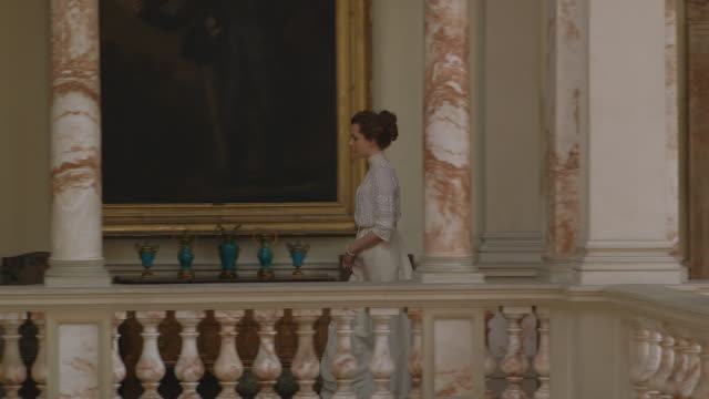 vídeos de stock, filmes e b-roll de  ms ts pan consuelo vanderbilt walking down hallway / united kingdom - reconstituição histórica