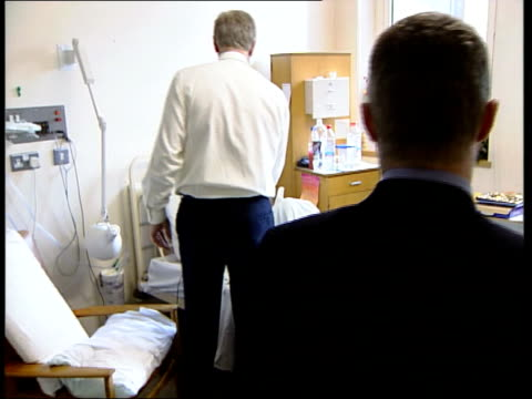 consultants; england: london: guy's hospital: int track forward into office to bv professor michael gleeson working at desk tcs gleeson's hand making... - double bed stock videos & royalty-free footage