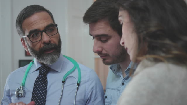 consultation in doctors office - parent stock videos & royalty-free footage