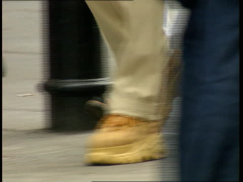 nike itn england london ext feet wearing trainers along street - nike designer label stock videos and b-roll footage