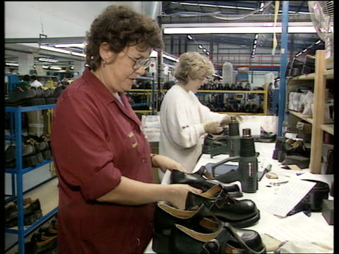 nike itn lib england northampton dr martens boots women working on boots in dr martens factory - northampton stock-videos und b-roll-filmmaterial