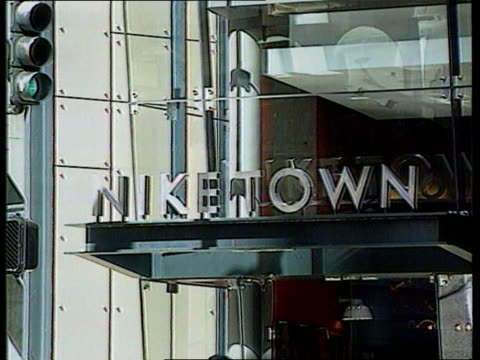 nike itn lib usa niketown sign on building int la customer looking at trainers displayed in shop - nike designer label stock videos and b-roll footage
