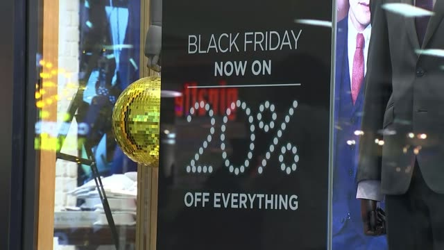 Consumer group Which warning over Black Friday deals ENGLAND Birmingham EXT People along past christmas markets stalls Father Christmas decoration...