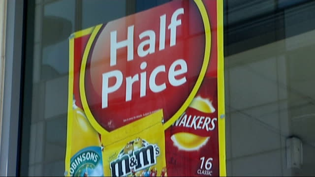 consumer watchdog criticises supermarket 'special offer' deals england ext 'half price' sign outside supermarket 'special offers' sign above display... - espositore per negozio video stock e b–roll