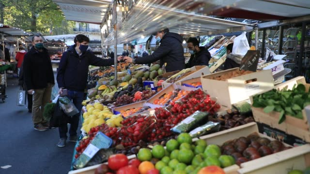 consumers buy fruits and vegetables at a food market during the first weekend of lockdown on october 31, 2020 in paris, france. the french government... - vendere video stock e b–roll