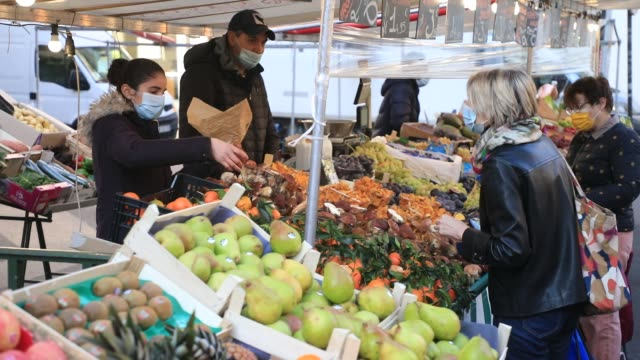consumers buy fruits and vegetables at a food market during the first weekend of lockdown on october 31, 2020 in paris, france. the french government... - fruit stock videos & royalty-free footage