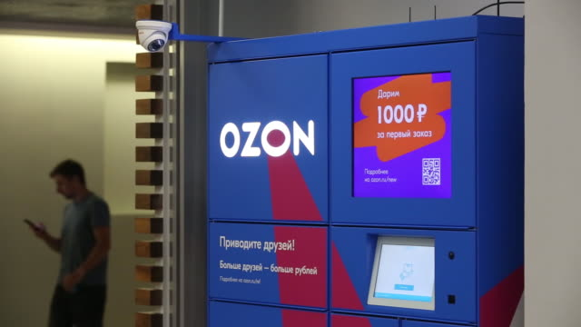 vídeos de stock, filmes e b-roll de consumers in collection point of ecommerce platform ozonru in moscow russia on wednesday july 31 2019 - escrita ocidental