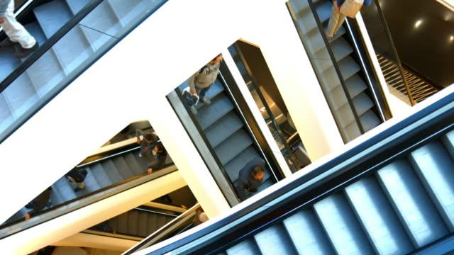 consumers riding escalator - escalator stock videos & royalty-free footage